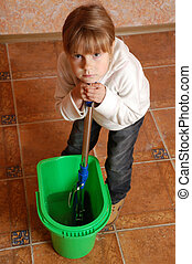 tired child cleaning up - tired little girl washing the...