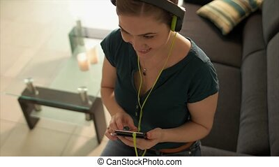 Woman Listening Music Podcast On Phone With Earphones -...