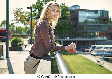 Blond woman resting in the hotels garden - Blond lady...