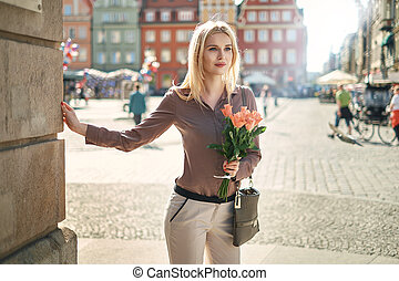 Blond lady waiting for her date