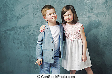 Adorable kids posing and hugging - Adorable children posing...