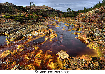 riotinto river with red waters produced by the copper mining