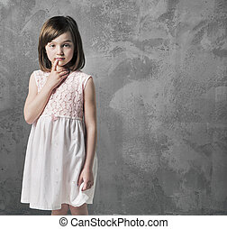 Portrait of a thoughtful little girl - Portrait of a...