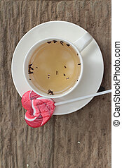 Hot tea in glass and candy sweet valentines heart