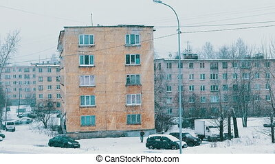 City Block of Flats Houses in Russia During Heavy Snowfall -...