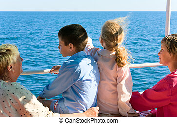 Sea sightseeing - family on excursion ship on sea background