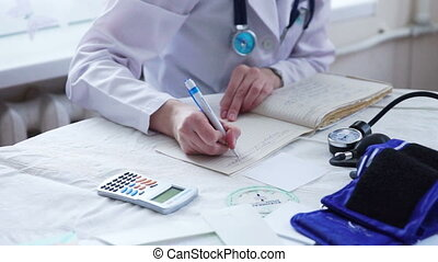 Doctor Hands in White Uniform Writing Prescription to a...