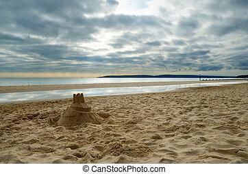 Sand Castle on the beach - A sandcastle on the beach in...