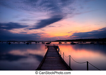 Sunset over Poole Harbour, Dorset (England) - Sunset on the...