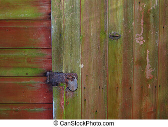 Old shed door with padlock - An old shed door with a rusty...