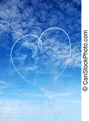 Heart in the sky - Heart shape skywritten against a blue...