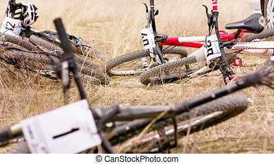 Sportive Bikes Lying On The Ground - CROSS-COUNTRY FROM...