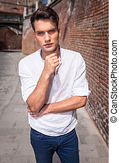 Attractive young fashion man standing