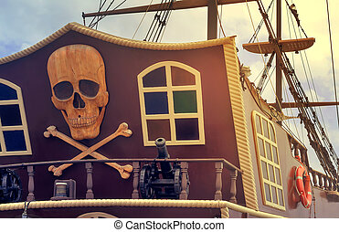 A fragment of the stern of a pleasure ship with a pirate...
