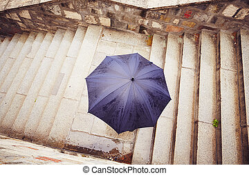Rain in the city - Man with blue umbrella