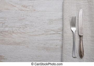 Old cutlery on cloth