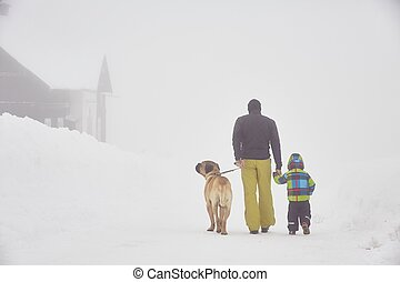 Wintry adventure - Father with son are walking in mountains...