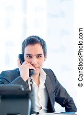 Young Businessman Talking on Phone at the Office - Close up...