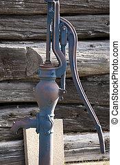 Vintage well pump photo taken in Iron River, MI