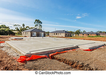 construction site - view of construction site and house...