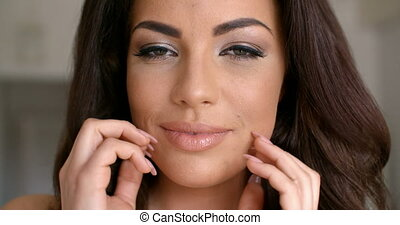 Pretty Young Woman Face with Hands on Sides - Close up...