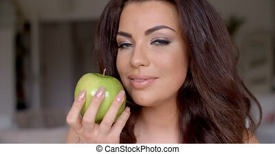 Smiling Pretty Woman Holding Fresh Green Apple