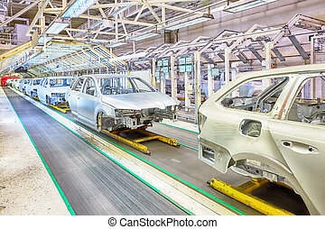 cars in a row at car plant - prepared chassis in a row at...