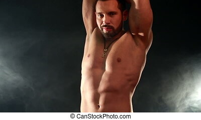 View of bearded macho sexy moves at camera - View of bearded...