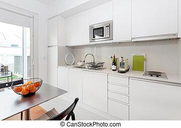modern kitchen with white furniture