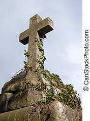 Gravestone - An old gravestone in the shape of a cross.