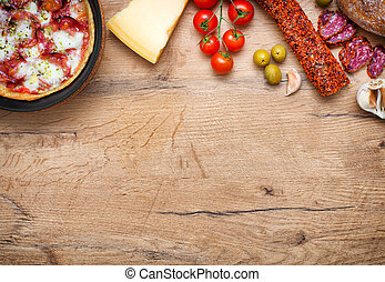 Top view of pizza in iron pan with ingredients. Place for your text.