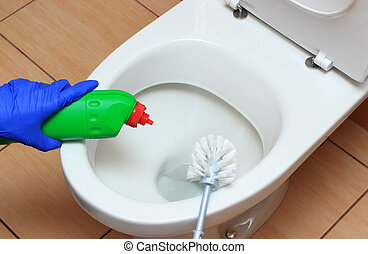 Hand of woman in blue glove cleaning toilet bowl using brush...