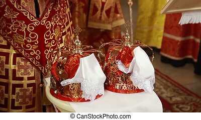 Two beautiful wedding crowns in church
