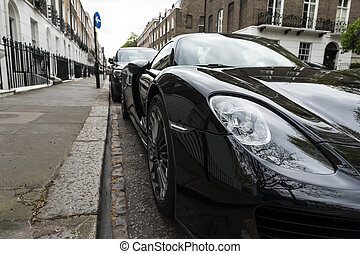 Luxury car parked in old European city street