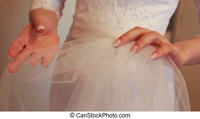 Bride holding beautiful wedding accessories