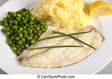 Baked fish, lemon and vegetables - A healthy meal of baked...