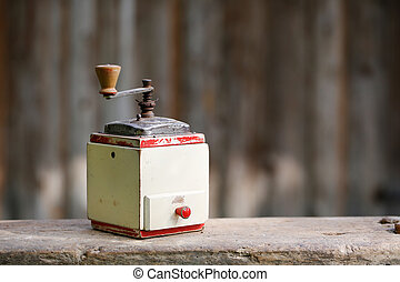 Hand-operated old wooden coffee or spices grinder with...