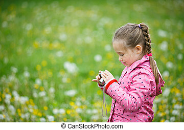 Little girl photographing with her camera - Little curious...