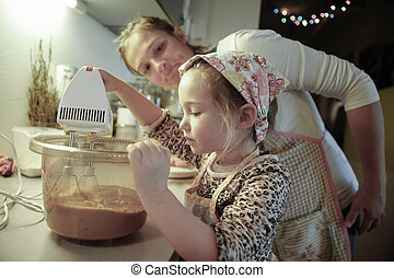 Mother tutoring her daughter in the kitchen
