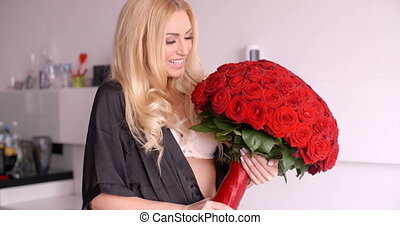 Happy Woman in Nightwear Holding Red Rose Bouquet - Happy...