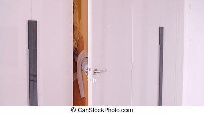 Sexy Girl in Lace Undies Standing at the Open Door