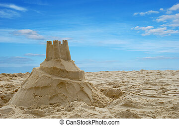 Sandcastle on a beach in summer - A sandcastle on a sandy...