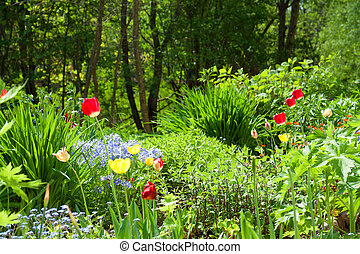 bed in a garden with beautiful flowers