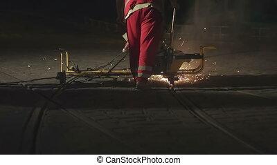 European Caucasian man fixing the rails - Adult European...