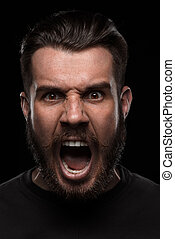 Portrait of young screaming man in studio - Portrait of...