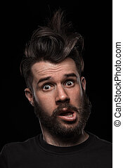 Portrait of young crazy man in studio - Portrait of young...
