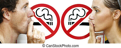 couple smoking a no smoking sign