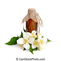 Flowers of a jasmine and pharmaceutical bottle Isolated