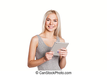 Woman using digital tablet computer happy isolated on white background.