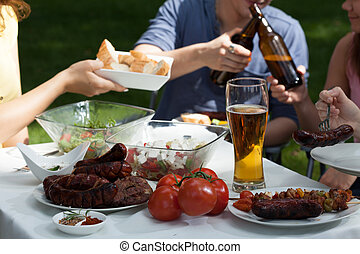 Friends enjoying themselves on garden party - Image of...